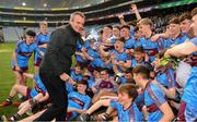 6 April 2019; The  St Michaels College players and the school principal Mark Henry celebrate with the Hogan cup after the Masita GAA Post Primary Schools Hogan Cup Senior A Football match between Naas CBS and St Michaels College Enniskillen at Croke Park in Dublin. Photo by Ray McManus/Sportsfile