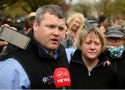 7 April 2019; Trainer Gordon Elliott, left, and Lynn Elliott, wife of the late Will Elliot, are welcomed home outside Shaw's pub in the village of Summerhill in County Meath following Tiger Roll's win at the 2019 Randox Health Aintree Grand National. Photo by Harry Murphy/Sportsfile