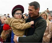7 April 2019; Jockey Davy Russell, with his son Finn, as the winner of the 2019 Randox Health Aintree Grand National Tiger Roll is led through the village of Summerhill in County Meath. Photo by Harry Murphy/Sportsfile