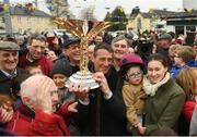7 April 2019; Jockey Davy Russell and family with the cup outside Shaw's pub in the village of Summerhill in County Meath following Tiger Roll's win at the 2019 Randox Health Aintree Grand National. Photo by Harry Murphy/Sportsfile