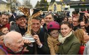 7 April 2019; Jockey Davy Russell holding the cup with family and supporters outside Shaw's pub in the village of Summerhill in County Meath following Tiger Roll's win at the 2019 Randox Health Aintree Grand National. Photo by Harry Murphy/Sportsfile