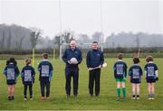 """8 April 2019; Uachtarán Chumann Lúthchleas Gael John Horan, left, and Ard Stiúrthóir of the GAA Tom Ryan with members of St Colmcilles GAA Club, from left, Reva Mehta, age 8, Milena Maza, age 8, Jack O'Byrne, age 10, Noah Noone Garland, age 9, Aisling Gillick, age 8, and Niall O'Donoghue, age 9, prior to the unveiling of the new GAA manifesto in both Irish and English at St Colmcilles GAA Club in Bettystown, Co Meath. The manifesto is an affirmation of the GAA's mission, vision and values, and a celebration of all the people who make the Association what it is. The intention is for the manifesto to be proudly displayed across the GAA network and wherever Gaelic Games are played at home and abroad"""". It marks the start of a wider support message that celebrates belonging to the GAA, which is centered around the statement: 'GAA – Where We All Belong' / CLG – Tá Áit Duinn Uilig'. Photo by Stephen McCarthy/Sportsfile"""