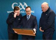 "8 April 2019; Keith Loughman, Chairman of St Colmcilles GAA Club, with Ard Stiúrthóir of the GAA Tom Ryan, left, and Uachtarán Chumann Lúthchleas Gael John Horan, right, at the unveiling of the new GAA manifesto in both Irish and English at St Colmcilles GAA Club in Bettystown, Co Meath. The manifesto is an affirmation of the GAA's mission, vision and values, and a celebration of all the people who make the Association what it is. The intention is for the manifesto to be proudly displayed across the GAA network and wherever Gaelic Games are played at home and abroad"". It marks the start of a wider support message that celebrates belonging to the GAA, which is centered around the statement: 'GAA – Where We All Belong' / CLG – Tá Áit Duinn Uilig'. Photo by Stephen McCarthy/Sportsfile"