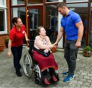 12 April 2019; MS Ireland are a charity partner of Leinster Rugby and as part of their partnership they will have a match day take-over at the RDS Arena tomorrow. Ahead of the game Leo Cullen and Seán O'Brien visited staff and patients at the MS Ireland Care Centre in Dublin. Pictured is Seán O'Brien with patient Margo Taplin. Photo by Ramsey Cardy/Sportsfile