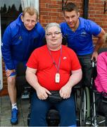 12 April 2019; MS Ireland are a charity partner of Leinster Rugby and as part of their partnership they will have a match day take-over at the RDS Arena tomorrow. Ahead of the game Leo Cullen and Seán O'Brien visited staff and patients at the MS Ireland Care Centre in Dublin. Pictured is head coach Leo Cullen and Seán O'Brien with resident Kieran Whelan. Photo by Ramsey Cardy/Sportsfile