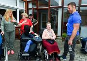 12 April 2019; MS Ireland are a charity partner of Leinster Rugby and as part of their partnership they will have a match day take-over at the RDS Arena tomorrow. Ahead of the game Leo Cullen and Seán O'Brien visited staff and patients at the MS Ireland Care Centre in Dublin. Pictured is Sean O'Brien with residents. Photo by Ramsey Cardy/Sportsfile