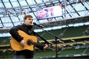 12 April 2019; Musician Jamie Webster performs prior to the Sean Cox Fundraiser match between the Republic of Ireland XI and Liverpool FC Legends at the Aviva Stadium in Dublin. Photo by Stephen McCarthy/Sportsfile.