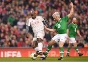 12 April 2019; Michael Thomas of Liverpool FC Legends in action against Stephen Hunt of Republic of Ireland XI during the Sean Cox Fundraiser match between the Republic of Ireland XI and Liverpool FC Legends at the Aviva Stadium in Dublin. Photo by Stephen McCarthy/Sportsfile