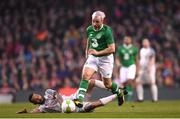 12 April 2019; Stephen Hunt of Republic of Ireland XI in action against Jermaine Pennant of Liverpool FC Legends during the Sean Cox Fundraiser match between the Republic of Ireland XI and Liverpool FC Legends at the Aviva Stadium in Dublin. Photo by Stephen McCarthy/Sportsfile