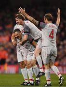 12 April 2019; John Aldridge of Liverpool FC Legends, left, celebrates after scoring their side's first goal with Steve McManaman and Jason McAteer during the Sean Cox Fundraiser match between the Republic of Ireland XI and Liverpool FC Legends at the Aviva Stadium in Dublin. Photo by Sam Barnes/Sportsfile