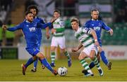 12 April 2019; Ronan Finn of Shamrock Rovers in action against Shane Duggan, left, and Karolis Chvedukas of Waterford during the SSE Airtricity League Premier Division match between Shamrock Rovers and Waterford at Tallaght Stadium in Dublin. Photo by Ramsey Cardy/Sportsfile