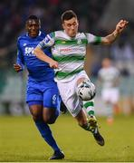 12 April 2019; Aaron Greene of Shamrock Rovers in action against Maxim Kouogun of Waterford during the SSE Airtricity League Premier Division match between Shamrock Rovers and Waterford at Tallaght Stadium in Dublin. Photo by Ramsey Cardy/Sportsfile