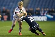 12 April 2019; Rob Lyttle of Ulster is tackled by Mark Bennett of Edinburgh during the Guinness PRO14 Round 20 match between Edinburgh and Ulster at BT Murrayfield in Edinburgh, Scotland. Photo by Ross Parker/Sportsfile