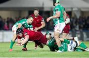 12 April 2019; Ciaran Parker of Munster  is tackled by Marco Lazzaroni of Benetton Treviso during the Guinness PRO14 Round 20 game between Benetton Treviso and Munster Rugby at Stadio di Monigo in Treviso, Italy. Photo by Roberto Bregani/Sportsfile