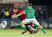 12 April 2019; JJ Hanrahan of Munster  is tackled by Federico Ruzza of Benetton Treviso during the Guinness PRO14 Round 20 game between Benetton Treviso and Munster Rugby at Stadio di Monigo in Treviso, Italy. Photo by Roberto Bregani/Sportsfile