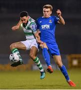 12 April 2019; Roberto Lopes of Shamrock Rovers in action against Aaron Drinan of Waterford during the SSE Airtricity League Premier Division match between Shamrock Rovers and Waterford at Tallaght Stadium in Dublin. Photo by Ramsey Cardy/Sportsfile