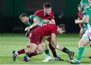 12 April 2019; Marco Zanon of Benetton Treviso is tackled by Billy Holland and Rhys Marshall of Munster during the Guinness PRO14 Round 20 game between Benetton Treviso and Munster Rugby at Stadio di Monigo in Treviso, Italy. Photo by Roberto Bregani/Sportsfile