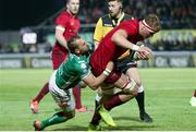 12 April 2019; Gavin Coombes of Munster  is tackled by Dewaldt Duvenage of Benetton Treviso during the Guinness PRO14 Round 20 game between Benetton Treviso and Munster Rugby at Stadio di Monigo in Treviso, Italy. Photo by Roberto Bregani/Sportsfile
