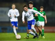 12 April 2019; Carter Lycett of England in action against Jake Ellis of Republic of Ireland during the SAFIB Centenary Shield Under 18 Boys' International match between Republic of Ireland and England at Dalymount Park in Dublin. Photo by Ben McShane/Sportsfile