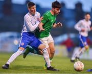 12 April 2019; Jake Ellis of Republic of Ireland in action against Carter Lycett of England during the SAFIB Centenary Shield Under 18 Boys' International match between Republic of Ireland and England at Dalymount Park in Dublin. Photo by Ben McShane/Sportsfile