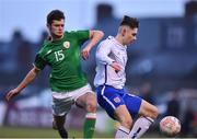 12 April 2019; James Dickson of England in action against Donal Higgins of Republic of Ireland during the SAFIB Centenary Shield Under 18 Boys' International match between Republic of Ireland and England at Dalymount Park in Dublin. Photo by Ben McShane/Sportsfile