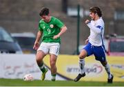 12 April 2019; Jake Ellis of Republic of Ireland has a shot on goal despite the attention of Levi Tarbotton of England during the SAFIB Centenary Shield Under 18 BoysÕ International match between Republic of Ireland and England at Dalymount Park in Dublin. Photo by Ben McShane/Sportsfile
