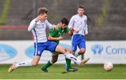 12 April 2019; Donal Higgins of Republic of Ireland in action against Adam Crowther of England during the SAFIB Centenary Shield Under 18 BoysÕ International match between Republic of Ireland and England at Dalymount Park in Dublin. Photo by Ben McShane/Sportsfile