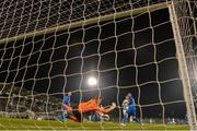 12 April 2019; Matthew Connor of Waterford saves a header by Ronan Finn of Shamrock Rovers during the SSE Airtricity League Premier Division match between Shamrock Rovers and Waterford at Tallaght Stadium in Dublin. Photo by Ramsey Cardy/Sportsfile