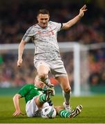 12 April 2019; Robbie Keane of Liverpool FC Legends is tackled by Kenny Cunningham of Republic of Ireland XI during the Sean Cox Fundraiser match between the Republic of Ireland XI and Liverpool FC Legends at the Aviva Stadium in Dublin. Photo by Stephen McCarthy/Sportsfile