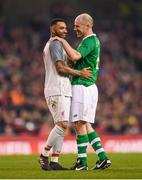 12 April 2019; Jermaine Pennant of Liverpool FC Legends and Kenny Cunningham of Republic of Ireland XI during the Sean Cox Fundraiser match between the Republic of Ireland XI and Liverpool FC Legends at the Aviva Stadium in Dublin. Photo by Stephen McCarthy/Sportsfile