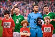 12 April 2019; Republic of Ireland XI players, from left, Robbie Keane, Wayne Henderson and Ian Harte with mascots prior to the Sean Cox Fundraiser match between the Republic of Ireland XI and Liverpool FC Legends at the Aviva Stadium in Dublin. Photo by Stephen McCarthy/Sportsfile