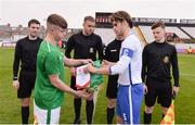 12 April 2019; Team captains, Niall O'Keeffe of Republic of Ireland, left, and Levi Tarbotton of England trade pennants prior to the SAFIB Centenary Shield Under 18 BoysÕ International match between Republic of Ireland and England at Dalymount Park in Dublin. Photo by Ben McShane/Sportsfile