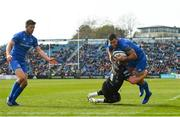 13 April 2019; Rob Kearney of Leinster on his way to scoring his side's third try despite the tackle of Ali Price of Glasgow Warriors during the Guinness PRO14 Round 20 match between Leinster and Glasgow Warriors at the RDS Arena in Dublin. Photo by Ramsey Cardy/Sportsfile