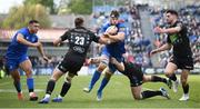 13 April 2019; Caelan Doris of Leinster is tackled by Glasgow Warriors players, from left, Huw Jones, Kyle Steyn and Adam Hastings during the Guinness PRO14 Round 20 match between Leinster and Glasgow Warriors at the RDS Arena in Dublin. Photo by Stephen McCarthy/Sportsfile