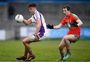 13 April 2019; Conor Casey of Kilmacud Crokes in action against Aaron Elliot of Ballymun Kickhams during the Dublin County Senior 1 Club Football Championship Round 1 match between Ballymun Kickhams and Kilmacud Crokes at Parnell Park in Dublin. Photo by Ramsey Cardy/Sportsfile