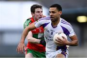 13 April 2019; Craig Dias of Kilmacud Crokes in action against Aaron Elliot of Ballymun Kickhams during the Dublin County Senior 1 Club Football Championship Round 1 match between Ballymun Kickhams and Kilmacud Crokes at Parnell Park in Dublin. Photo by Ramsey Cardy/Sportsfile