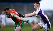 13 April 2019; Liam O'Donovan of Ballymun Kickhams in action against Nathan Nolan of Kilmacud Crokes during the Dublin County Senior 1 Club Football Championship Round 1 match between Ballymun Kickhams and Kilmacud Crokes at Parnell Park in Dublin. Photo by Ramsey Cardy/Sportsfile