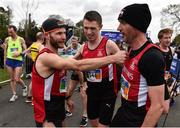 14 April 2019;  Kyle Doherty, left, Emmett Mcginty and Steven Mcalary of City of Derry A.C. Spartans, Co. Derry, celebrate following the Great Ireland Run 2019 in conjunction with AAI National 10k Championships at Phoenix Park in Dublin. Photo by Sam Barnes/Sportsfile