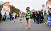 14 April 2019; Catherina Mullen of Metro St. Brigids A.C., Co. Dublin, crosses the line to win the Women's race during the Great Ireland Run 2019 in conjunction with AAI National 10k Championships at Phoenix Park in Dublin. Photo by Sam Barnes/Sportsfile