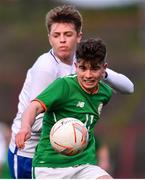12 April 2019; Colin Kelly of Republic of Ireland in action against Adam Crowther of England during the SAFIB Centenary Shield Under 18 Boys' International match between Republic of Ireland and England at Dalymount Park in Dublin. Photo by Ben McShane/Sportsfile