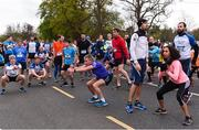14 April 2019; Runners take part in the mass warm up ahead of the Great Ireland Run 2019 in conjunction with AAI National 10k Championships at Phoenix Park in Dublin. Photo by Sam Barnes/Sportsfile