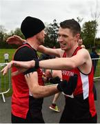 14 April 2019; Emmett McGinty of City of Derry A.C. Spartans, right, is congratulated by team-mate Steven Mcalary following the Great Ireland Run 2019 in conjunction with AAI National 10k Championships at Phoenix Park in Dublin. Photo by Sam Barnes/Sportsfile