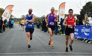 14 April 2019; Runners cross the finish line during the Great Ireland Run 2019 in conjunction with AAI National 10k Championships at Phoenix Park in Dublin. Photo by Sam Barnes/Sportsfile