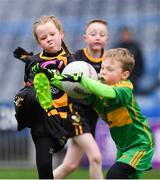 14 April 2019; Emma Condra of Nobber, Co Meath, in action against Daniel Connaughton of Tubberclair, Co Westmeath, during the Littlewoods Ireland Go Games Provincial Days in Croke Park. This year over 6,000 boys and girls aged between six and twelve represented their clubs in a series of mini blitzes and just like their heroes got to play in Croke Park. Photo by Piaras Ó Mídheach/Sportsfile