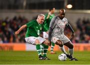 12 April 2019; Michael Thomas of Liverpool FC Legends in action against Ray Houghton of Republic of Ireland XI during the Sean Cox Fundraiser match between the Republic of Ireland XI and Liverpool FC Legends at the Aviva Stadium in Dublin. Photo by Sam Barnes/Sportsfile