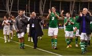 12 April 2019; Players from both sides including Niall Quinn of Republic of Ireland XI, centre,  applaud the fans following the Sean Cox Fundraiser match between the Republic of Ireland XI and Liverpool FC Legends at the Aviva Stadium in Dublin. Photo by Sam Barnes/Sportsfile