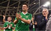12 April 2019; Niall Quinn, centre, and Graham Kavanagh of Republic of Ireland XI, applaud the fans following the Sean Cox Fundraiser match between the Republic of Ireland XI and Liverpool FC Legends at the Aviva Stadium in Dublin. Photo by Sam Barnes/Sportsfile