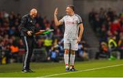 12 April 2019; John Aldridge of Liverpool FC Legends jokes with fourth official Paul Tuite during the Sean Cox Fundraiser match between the Republic of Ireland XI and Liverpool FC Legends at the Aviva Stadium in Dublin. Photo by Sam Barnes/Sportsfile