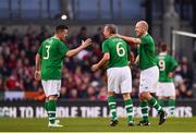 12 April 2019; Ronnie Whelan of Republic of Ireland XI is congratulated by Ian Harte, left, and Kenny Cunningham, right, after being substituted during the Sean Cox Fundraiser match between the Republic of Ireland XI and Liverpool FC Legends at the Aviva Stadium in Dublin. Photo by Sam Barnes/Sportsfile