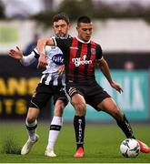 15 April 2019; Ali Reghba of Bohemians in action against Dean Jarvis of Dundalk during the SSE Airtricity League Premier Division match between Dundalk and Bohemians at Oriel Park in Dundalk, Louth. Photo by Stephen McCarthy/Sportsfile